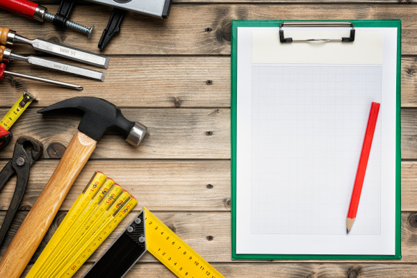work tools for carpenter and notepads
