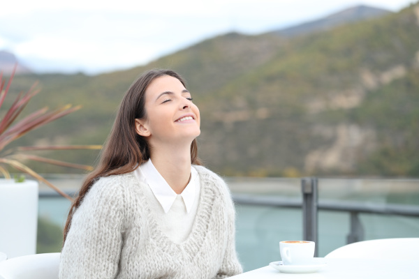 happy girl breathing fresh air in