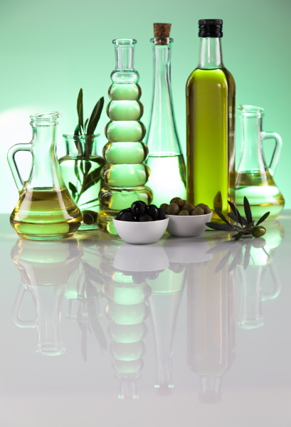 bottles with organic cooking olive oil