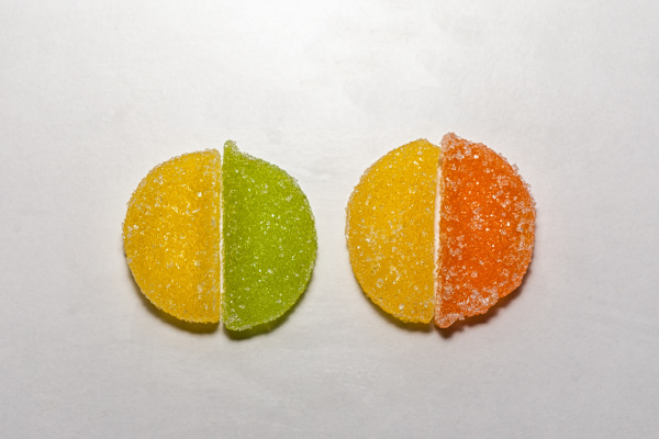 four sugar candies shaped as two