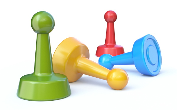 group of four game pawns 3d