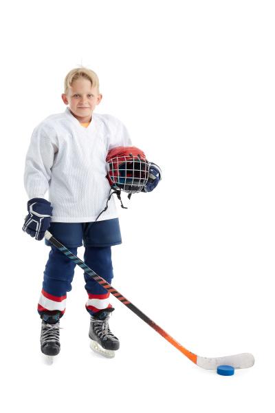 little boy is hockey player