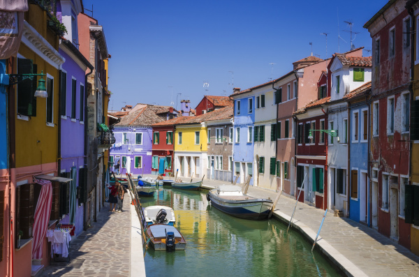 colorful houses and canal burano veneto