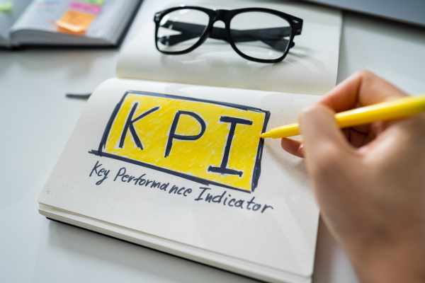 businessperson drawing key performance indicator concept