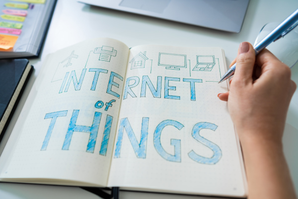 businessperson drawing iot concept
