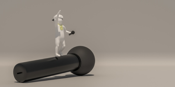 the white character holds a microphone