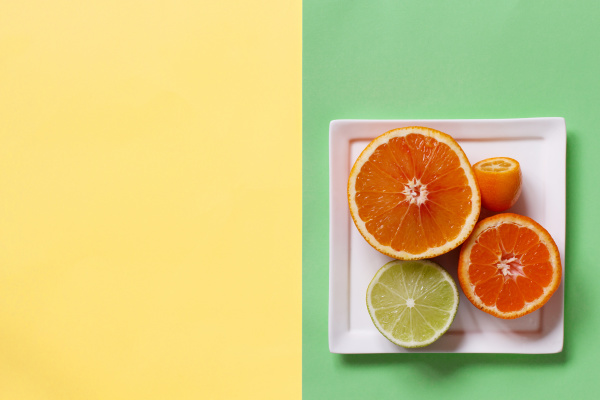 citrus fruits on a yellow and