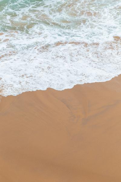 ocean coast moviment white foam on