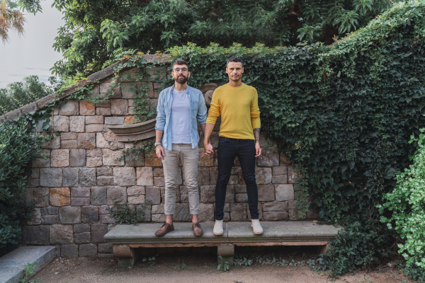 portrait of gay couple standing hand