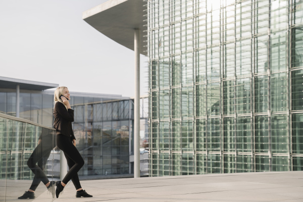 blond businesswoman using smartphone in the