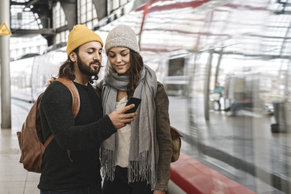 young couple using smartphone at the