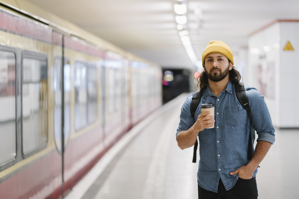 portrait of man with backpack and