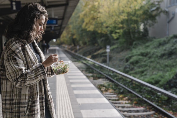 woman having lunch on an underground