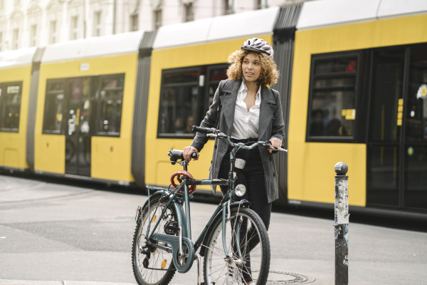 woman with bicycle commuting in the