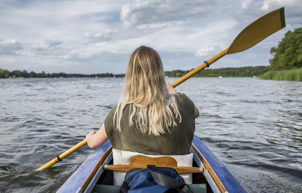 woman paddling on a lake