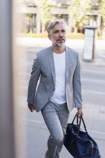 fashionable mature businessman with travelling bag