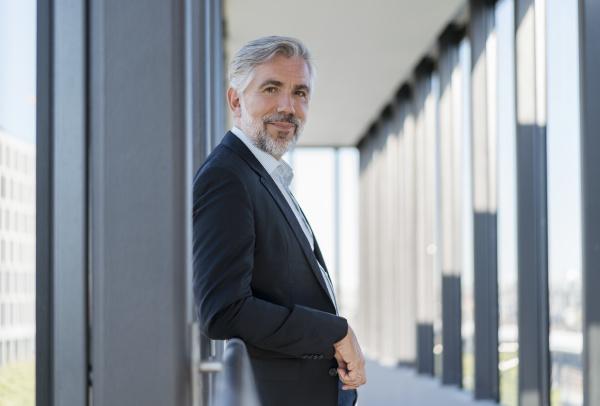 portrait of mature businessman leaning on