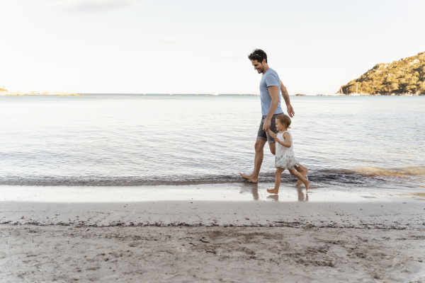 happy father walking with daughter on