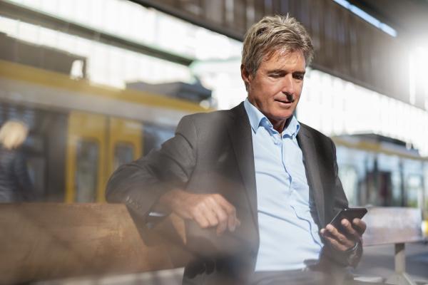 mature businessman waiting at station platform