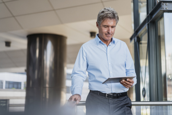 mature businessman using tablet in the