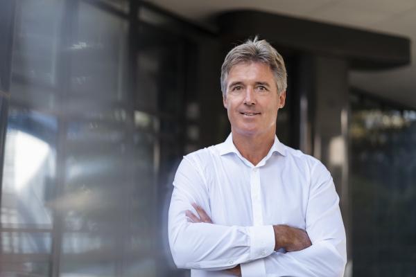 portrait of confident mature businessman outside