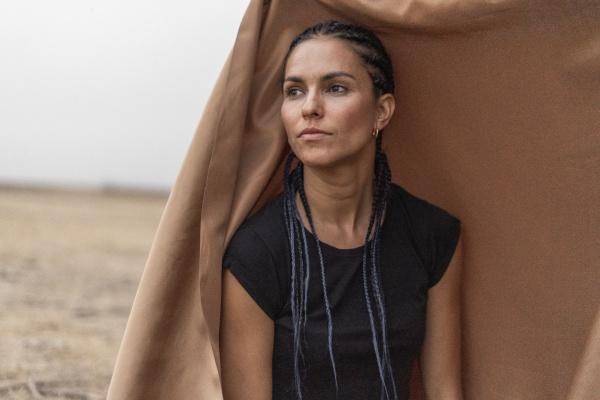 portrait of woman in bleak landscape