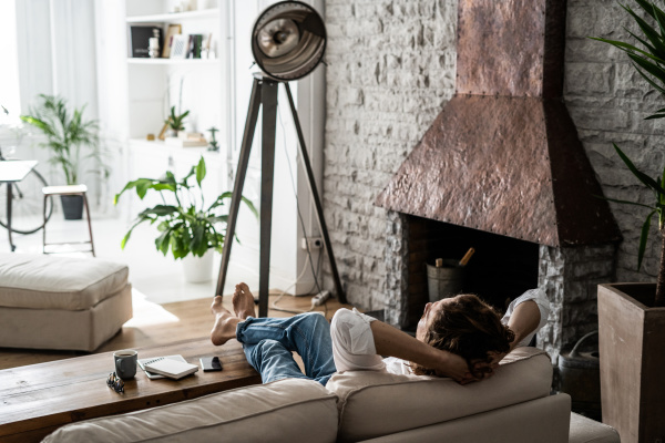 relaxed man leaning back on couch