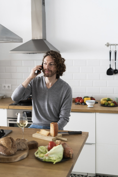 man on the phone in kitchen