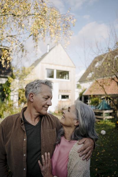 happy senior couple in garden of
