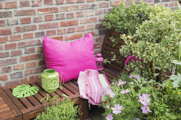balcony with bench pink cushion