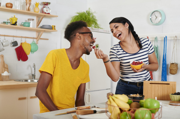 multiethnic couple breakfasting together in the