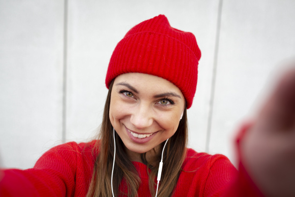woman wearing red pullover and wolly