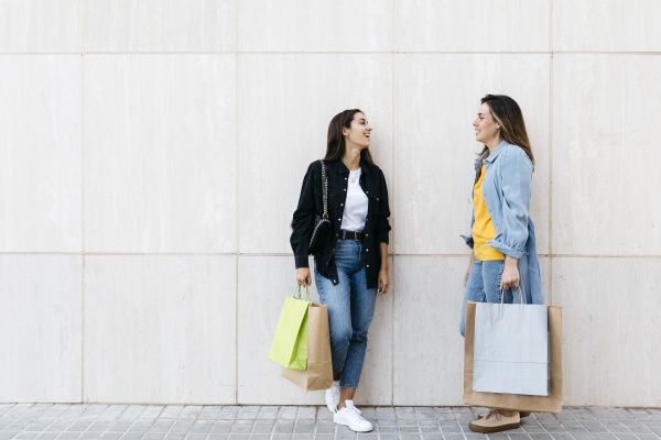 two friends talking during shopping