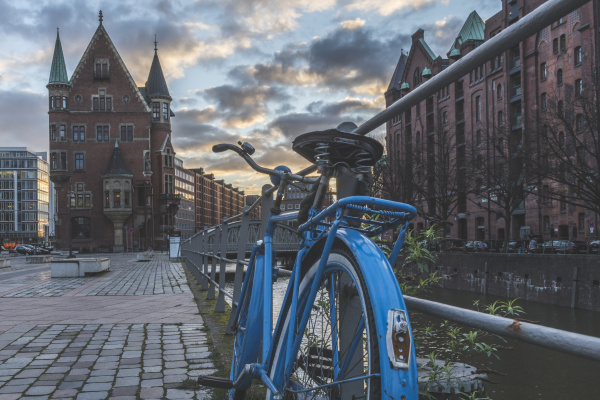 bicycle parked on footpath against speicherstadt
