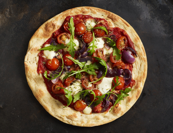 close up of pizza with tomatoes