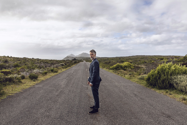 businessman standing on country road cape