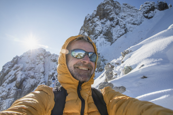 selfie of a happy mountaineer on