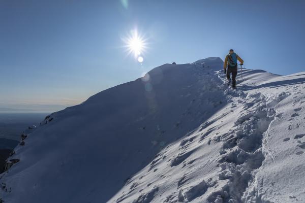 mountaineer hiking on snowy mountain