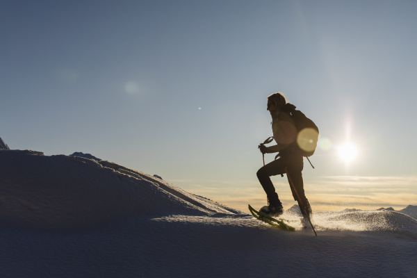 woman walking with snowshoes in fresh