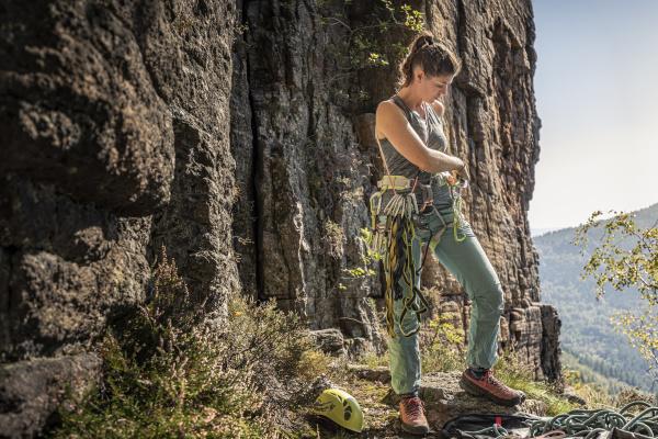 woman preparing to climb putting