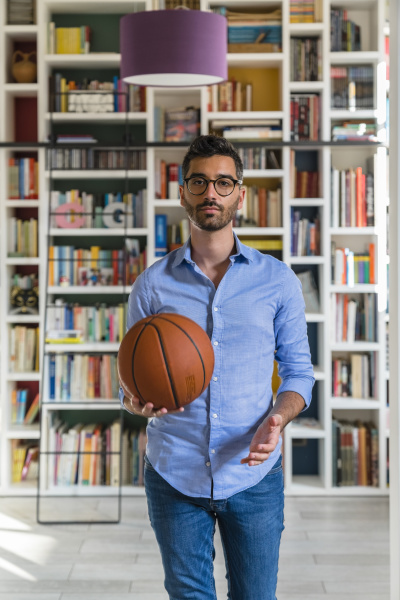 portrait of young man with basketball