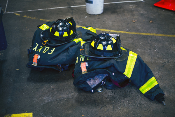 firefighter uniforms and helmets in fire