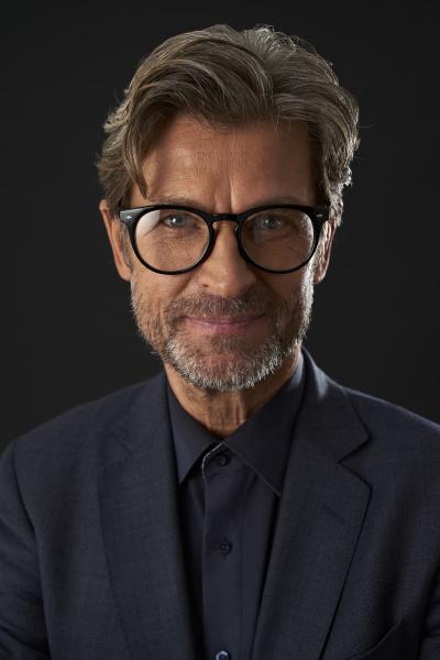 portrait of smiling mature businessman wearing