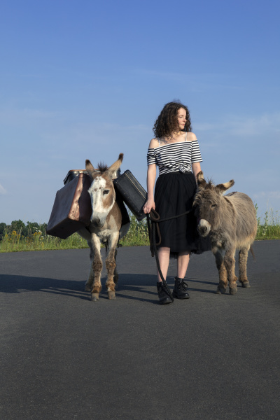 young woman on country road with