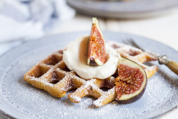 thick belgianwaffle with whipped cream powdered
