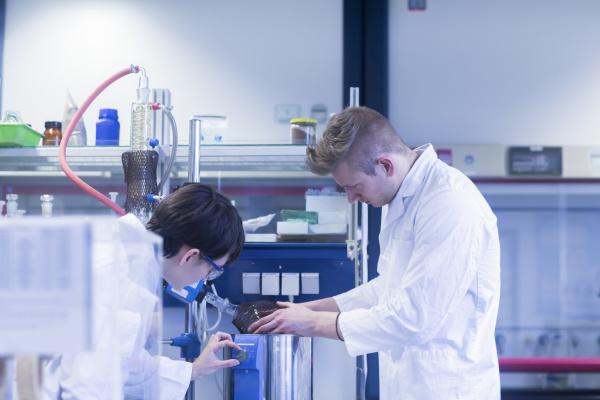 female and male laboratory technician working