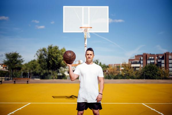 basketball player posing at camera with