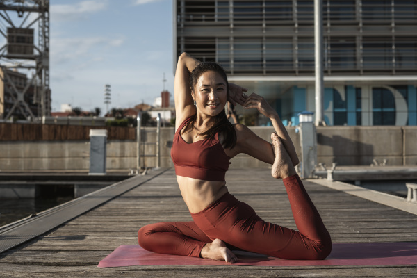 asian woman practicing yoga on a
