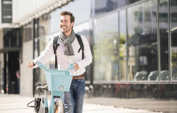 smiling young man with bicycle in