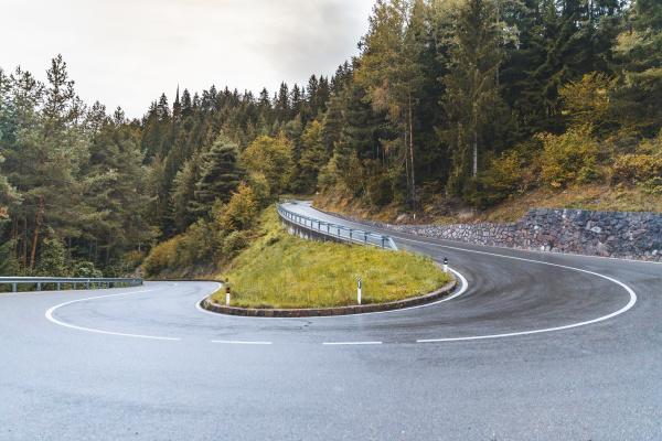 empty winding road at italian alps